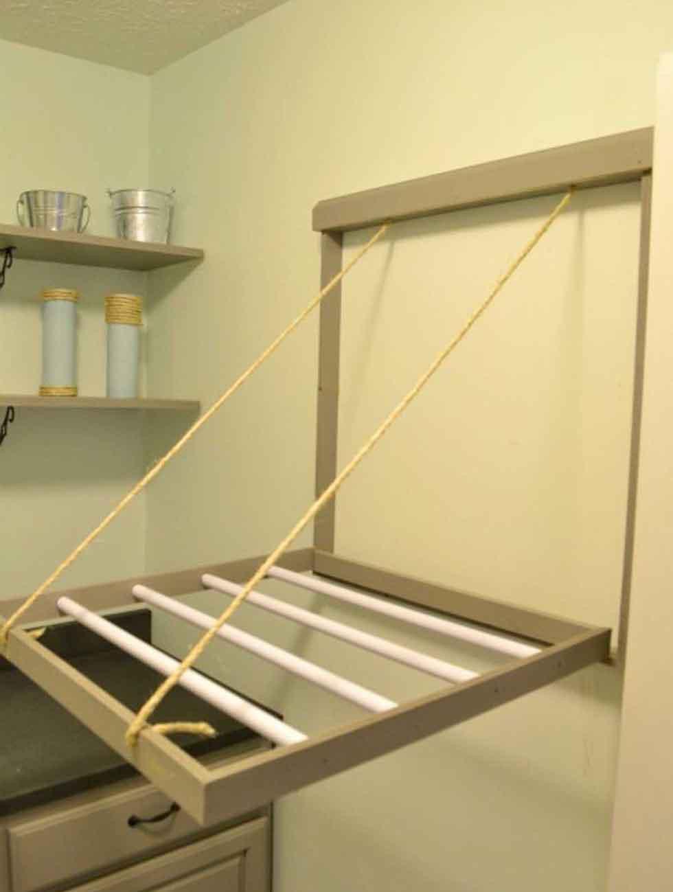 تنظيم غرفة الغسيل - منشر عملي سهل الطي